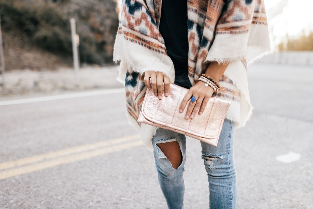 Camino Brands rose gold clutch