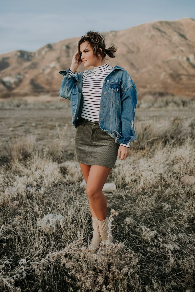 Green mini skirt and denim jacket