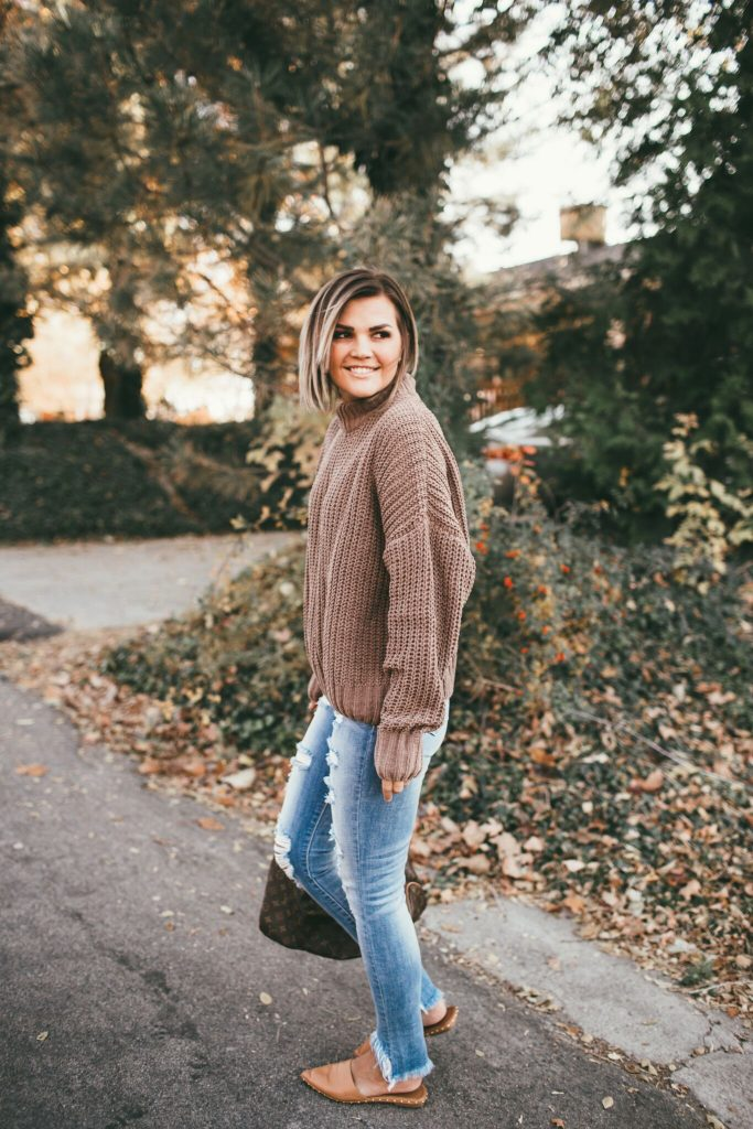 soft mocha sweater and shredded jeans