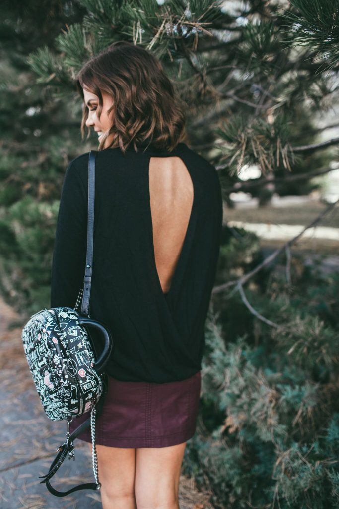 Burgundy leather skirt and Henri Bendel Pretty in Punk Backpack