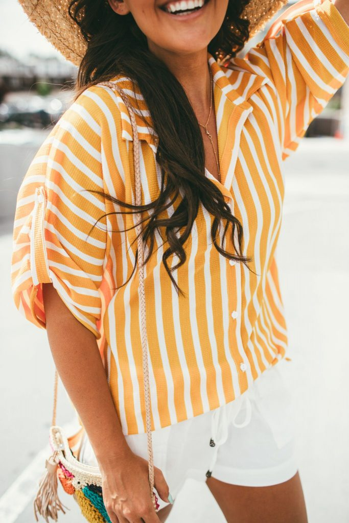 Yellow striped shirt and white linen shorts