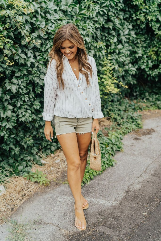 White striped button down blouse and olive unpublished denim shorts