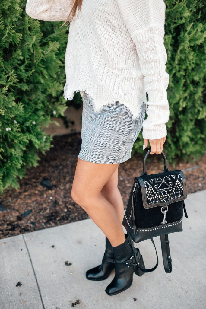 Shein Plaid skirt and destroyed sweater, dolce vita moto boots, rebecca minkoff studded backpack