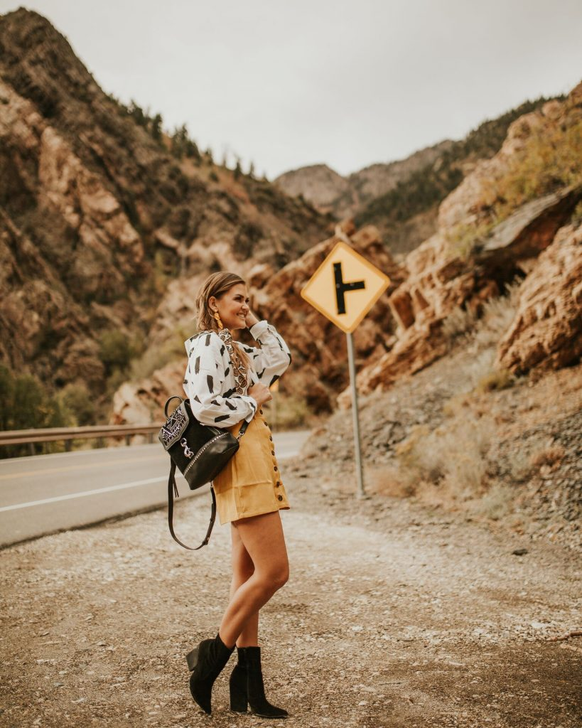 Shein printed blouse and yellow skirt, Rebecca Minkoff Studded backpack