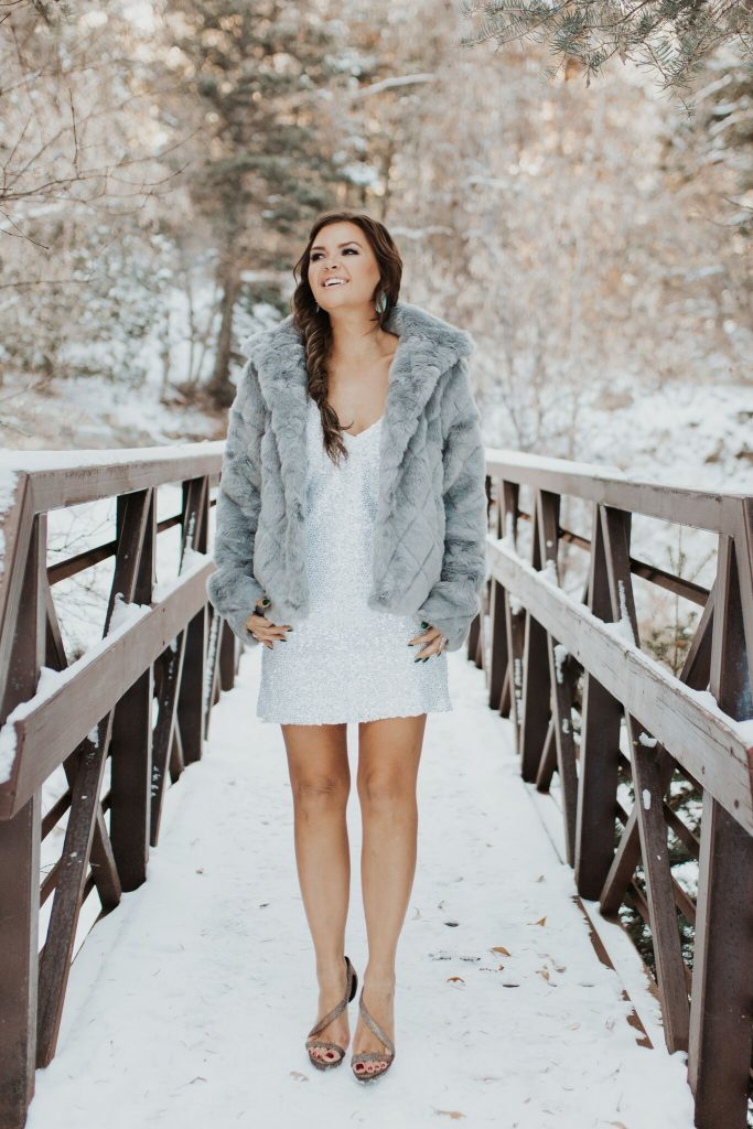 Lulu's grey faux fur coat and white sequin mini dress